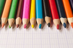 Colouring pencils on notebook background Stock Photography