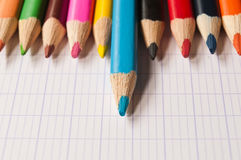 Colouring pencils on notebook background Royalty Free Stock Photo