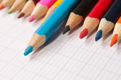 Colouring pencils on notebook background Royalty Free Stock Photos