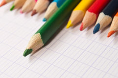 Colouring pencils on notebook background Royalty Free Stock Images