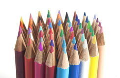 Colouring pencils stood  up in a group. A bundle of colouring pencils all together Stock Photo