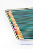 Colouring pencils in tin. Close up of brand new colouring pencils in a tin. Shallow depth of field Royalty Free Stock Photos