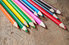 Colouring pencils on wooden background Royalty Free Stock Image