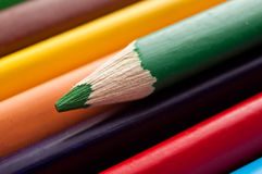 Colouring pencils on wooden background Royalty Free Stock Photography