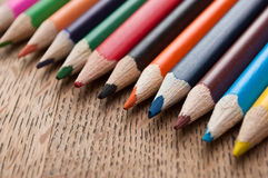 Colouring pencils on wooden background Royalty Free Stock Photos