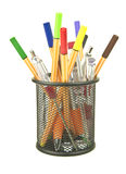 Colouring pens and junk in desk tidy Royalty Free Stock Photography