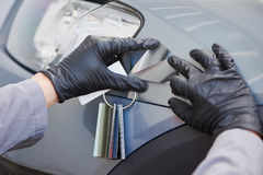 Colourist man selecting color of car with paint matching samples. Auto colour matching. colourist man selecting color of car at automobile repair and renew royalty free stock photography