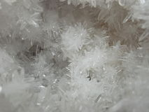 Colourless natural crystals. A pocket of needle-like colourless transparent crystals royalty free stock images