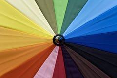 Colours. An umbrella made of  colored fabrics Stock Photos