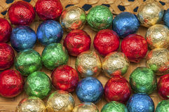 Colours. Coloured chocolate balls on wooden background Stock Images