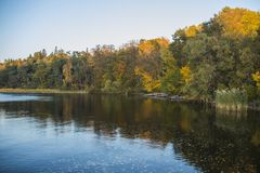 The colours of autumn. Enjoying the colours of an autumn afternoon along one of Sweden`s lake stock image