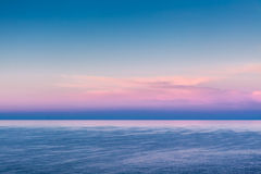 Colours of Dawn. Beautiful natural colours of a late summer dawn shot from the cliffs at Mtahleb in Malta stock photography