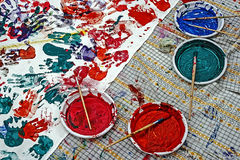 Colours and designs made with palms of childrens Stock Photo