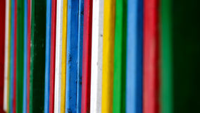 Colours. Different colours on a fence stock photos