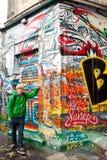 Colours everywhere. Colourfoul guy near very colourful wall Stock Photos