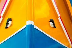 Colours of the Maltese Dghajsa. Abstract close up view of the vibrant colours and design usually used on the traditional Maltese fishing boat, the Dghajsa or Stock Photos