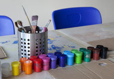 Colours. Set of school colours in jars on the table Stock Photography