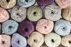 Colours of yarns in white background Stock Photos