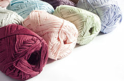 Colours of yarns in white background Royalty Free Stock Photos