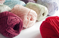 Colours of yarns in white background Stock Images
