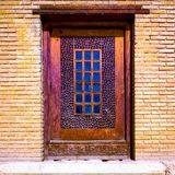 A single sash window in the Arg-e Karim Khan. Shiraz, Iran. A coloorful sash window in the Arg-e Karim Khan, Shiraz, Iran stock photography