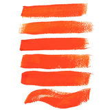 Colpi arancio della spazzola dell'inchiostro Fotografie Stock Libere da Diritti