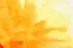 Colpi arancioni della spazzola dell'acquerello Fotografie Stock