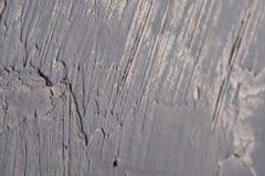 Colpi caotici inflitti stucco grigio Fotografia Stock Libera da Diritti