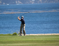 Colpi del giocatore di golf Fotografie Stock