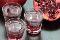 Colpi della vodka del melograno Immagine Stock Libera da Diritti