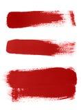 Colpi rossi della spazzola su priorità bassa bianca Immagine Stock Libera da Diritti