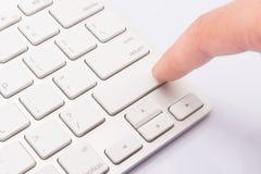 Colpisca una tastiera in bianco Immagini Stock
