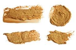 Colpo acrilico astratto della spazzola dell'oro Isolato Immagine Stock Libera da Diritti