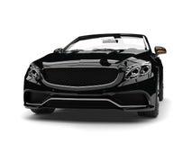 Colpo automobilistico convertibile di lusso moderno nero del primo piano di vista frontale di notte royalty illustrazione gratis