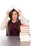 Colpo dello studio dello studente infelice con il libro sulla testa che si siede a Fotografia Stock Libera da Diritti