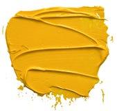Colpo giallo strutturato della spazzola della pittura ad olio immagini stock