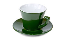 Colpo laterale della tazza di caffè verde vuota Fotografia Stock