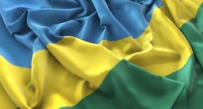 Colpo macro meravigliosamente d'ondeggiamento del primo piano increspato bandiera del Ruanda immagini stock