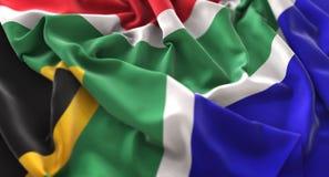 Colpo macro meravigliosamente d'ondeggiamento del primo piano increspato bandiera del Sudafrica fotografia stock libera da diritti