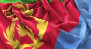 Colpo macro meravigliosamente d'ondeggiamento del primo piano increspato bandiera dell'Eritrea fotografie stock