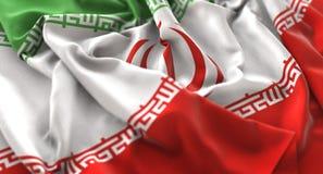 Colpo macro meravigliosamente d'ondeggiamento del primo piano increspato bandiera dell'Iran immagine stock