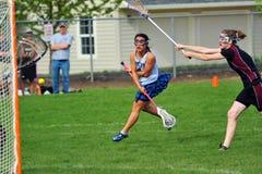 Colpo mj della squadra di college delle ragazze di Lacrosse Fotografia Stock