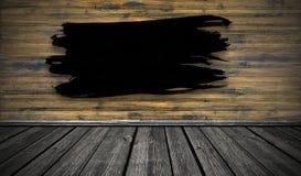 Colpo nero del pennello su fondo di legno Copi lo spazio immagine stock libera da diritti