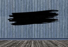 Colpo nero del pennello su fondo di legno Copi lo spazio immagine stock