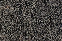 Colpo potato di asfalto nero fotografia stock libera da diritti