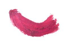 Colpo rosa del rossetto di colore su Libro Bianco Fotografia Stock