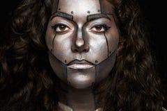 Colpo in testa delle donne con il fronte dipinto Fotografie Stock