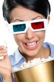 Colpo in testa dello spettatore che mangia popcorn Fotografia Stock