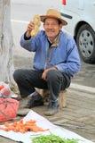 Colporteur Selling Potato photo stock