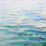 Colrful oil slick on the water Royalty Free Stock Photo